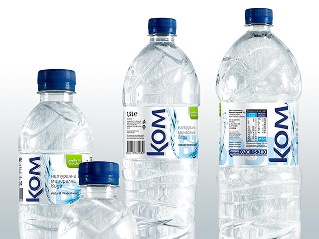 KOM Mineral water labels.
